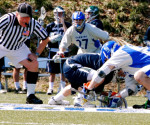 Junior midfielder Mike Gurenlian faces off against the midfielder from Drew University. This win improved the Cavs record,  which is currently 4-3. Mary Jacobs/ staff photographer
