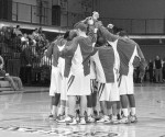 The Cabrini men's basketball team huddles together in center court before a game during the 2008-2009 season.  --Cabrini Athletic Department