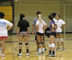 The women's volleyball team takes a break during preseason practices last week while head coach, Eric Schaefer prepared the team for the next drill.
