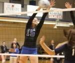 Michele Fitz blocks a hit from Neuman College -Lauren Sliva/Online Media Editor