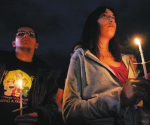 Rutgers University students hold a candlelight vigil for Tyler Clementi, 18, who took is own life after being filmed having sexual relations with another male student. Clementi is just one of five gay teens that committed suicide after facing harassment in recent weeks-- MCT