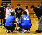 "Three Cabrini College basketball players huddled with their team at the ""Hoops from the Heart"" clinic before playing in a scrimmage against one of the other teams."