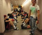 Students in East Residence Hall wait for tornado warning to pass after being evacuated to the basement.