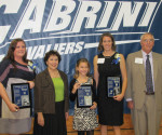 From left to right, Christy Malone, Dr. Marie Angelella George, Olivia Anderlonis (representing Tim Anderlonis), Megan Dillon Grant and Duncan Hubley pose for a photo after receiving their plaques at Cabrini's 2011 Athletic Hall of Fame ceremony on Friday, Sept. 23. -- Cabrini College Athletics Department / Submitted Photo
