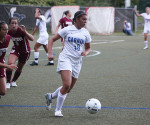 Sophomore Melissa Scanzano (No. 18) plays the ball during Cabrini's 3-0 loss to Eastern University on Wednesday, Sept. 12. (Staff Writer / Nick Cipollone)