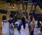 The Lady Cavs celebrate after defeating Gwynedd-Mercy in the CSAC Final, 49-38, on Saturday, Feb. 23. They travel to face Catholic University on Friday, March 1 in the first round of the NCAA Tournament. (Kevin Durso / Sports Editor)
