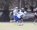 Bobby Thorp (No. 8) scored five goals in the Cavaliers' 15-7 win over Swarthmore College on Saturday, March 9. The win improved the Cavs to 2-2 on the season. (Kevin Durso / Sports Editor)