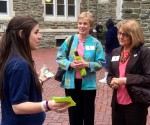 CRS Ambassador Emily Janny explains to CRS Executive Vice President Joan Rosenhauer how children are fleeing Latin America for their safety. Professor Suzanne Toton of Villanova University looks on.