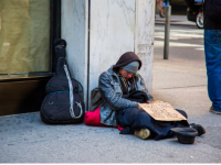 Photo Credits: Public Domain Pictures. Homeless man on the street asking for money