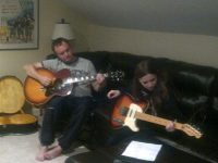 Me and Sean, my stepdad, teaching my to play guitar